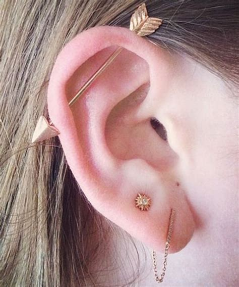 absolutely staggering top ear piercings inkdoneright
