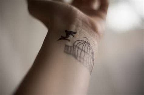 flying birds tattoo on wrist 27 dazzling bird cage wrist tattoos