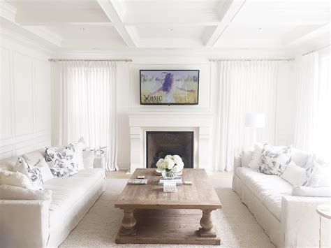 white coastal home painted in benjamin moores simply