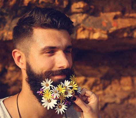 stubble buffer guys are decorating their beards with flowers to celebrate