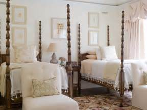Four poster twin beds in a traditional guest room above