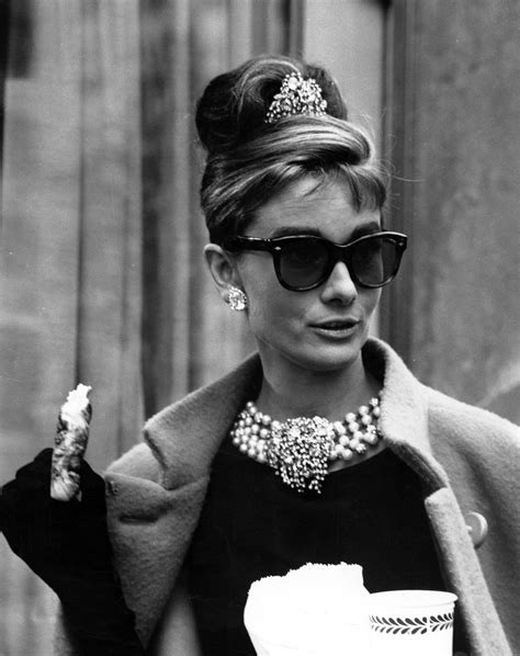 Hepburn In Breakfast At Tiffanys by Hepburn Removing The Mask