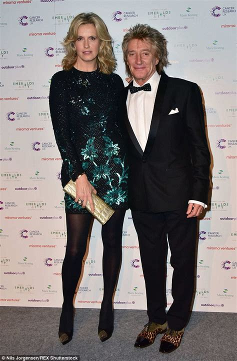 why did the rug roll around his rod stewart looks suave in a tuxedo as he cuddles up to lancaster daily mail