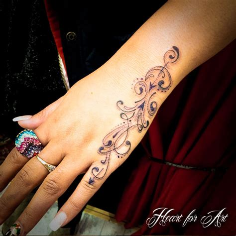 wrist and finger tattoos 9i pretty designs