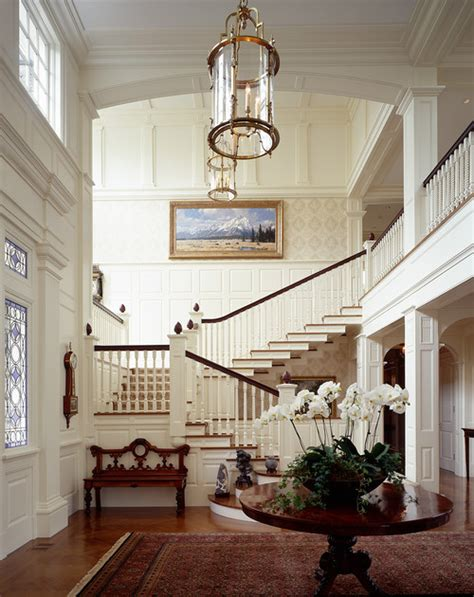 big white staircase beautiful wooden floors high elegant foyer and staircase content in a cottage