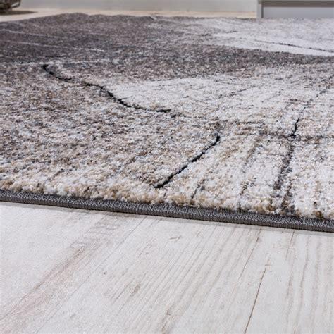 teppiche natur teppich wohnzimmer holzstamm optik natur grau braun design