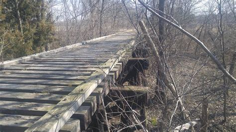 Single Plank Bridge flint nature trail rail trail photo singletracks