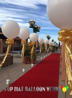 themes in the black balloon film red carpet high heel shoe balloon sculpture feather boas