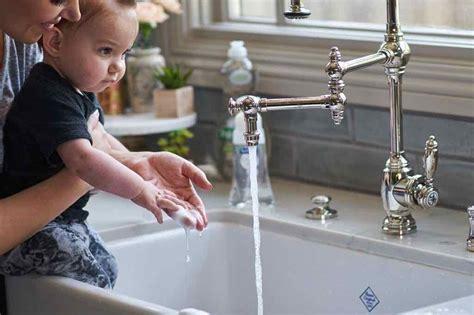 washing baby in kitchen sink teaching baby to wash their real s kitchen
