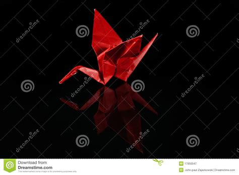 Black Origami Paper - paper origami crane on black royalty free stock