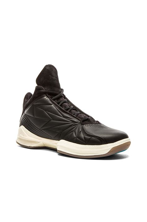 brandblack sneakers lyst brandblack xb vector sneakers in black for