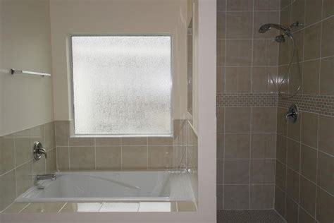 Interior frosted glass bathroom window jetted tub shower combo contemporary wall light 49