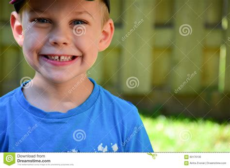 hairbrush for boy 4yr old four year old caucasian boy close up face stock photo