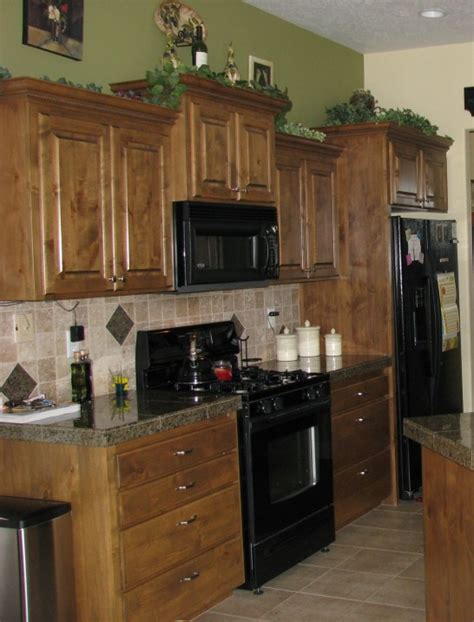 Green Kitchen Walls Brown Cabinets Green Wall Paint Brown Wooden Kitchen Cabinet And