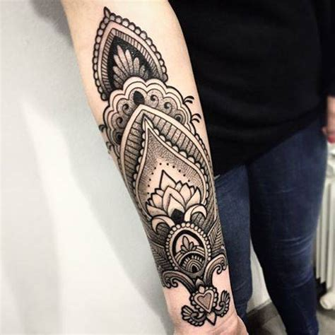 henna style tattoo on the right inner forearm