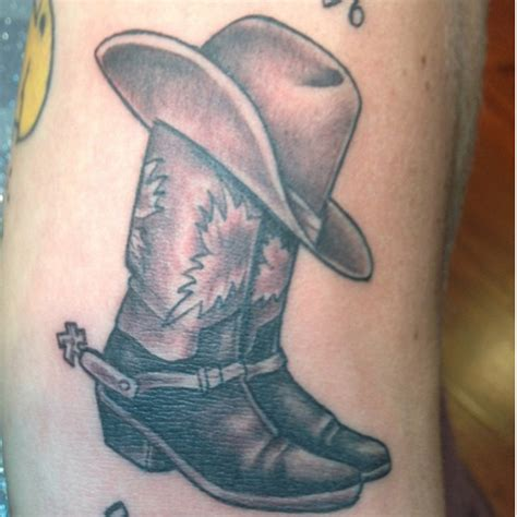 cowboy hat tattoo cowboy boots and hat