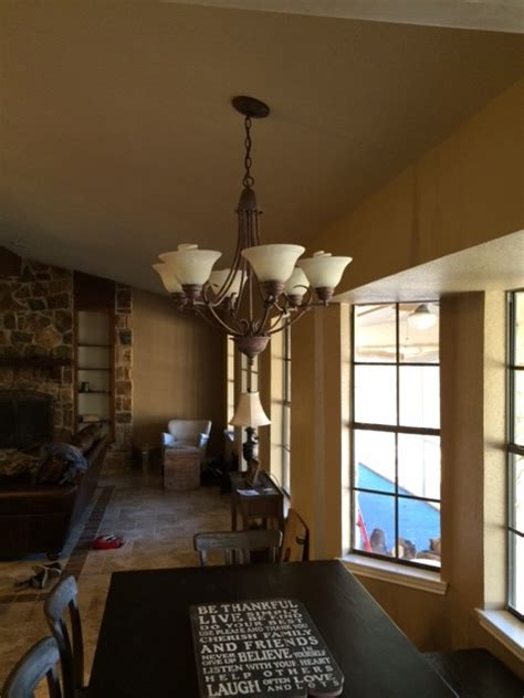 mounting a large light fixture to sloped ceiling or