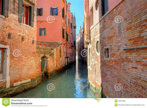 houses in venice italy narrow canal among old houses in venice italy stock