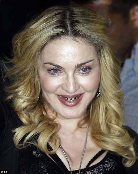madonna shows off gold teeth grills as she visits hard