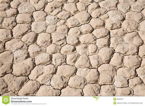 photography ground pattern dry mud cracked desert ground background pattern stock