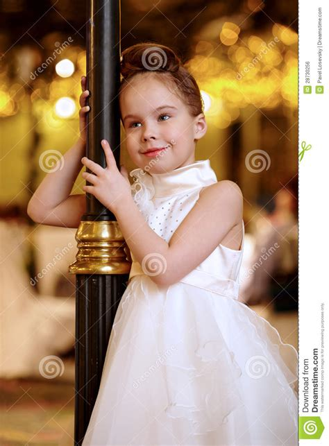 girl  evening dress stands smiling royalty
