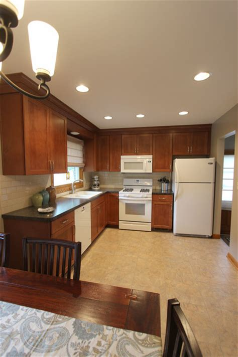 redesigning a small kitchen small kitchen redesign with maple cabinets and laminate