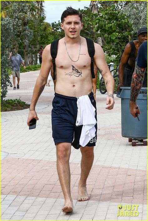 brooklyn beckham hits the beach in miami shirtless
