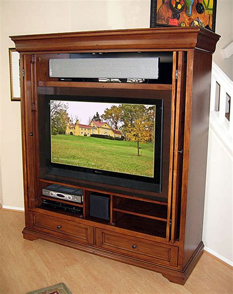 tv armoires with pocket doors tuscany armoire wall unit hide your flat panel tv behind
