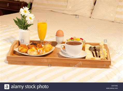 breakfast in bed table full breakfast tray with flowers on the bed stock photo royalty free image 68160192 alamy