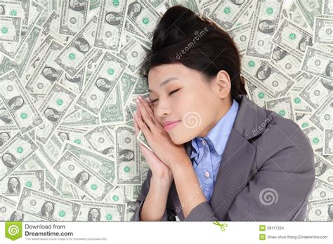 bed of money business woman sleeping on money bed stock images image