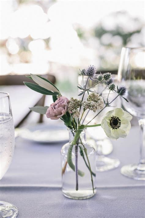 bud centerpiece with anemone carnation olive and thistle for a wedding with a lavender