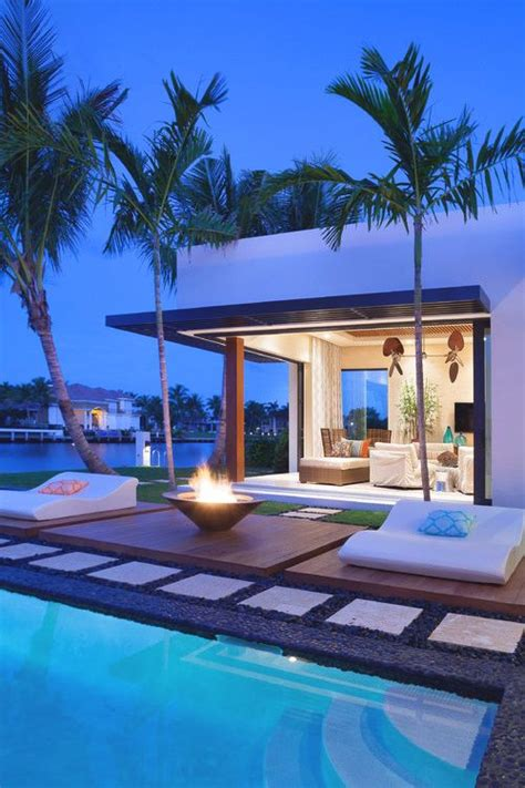 beach house backyard modern back yard outdoors palm trees pool mansion