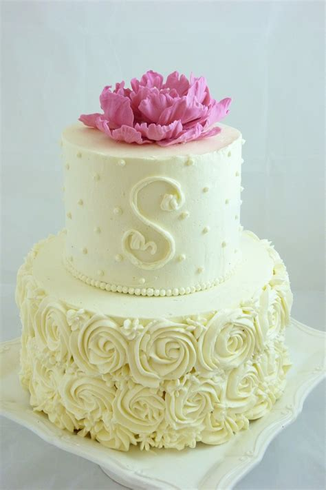 buttercream decorated small wedding cake with piped roses