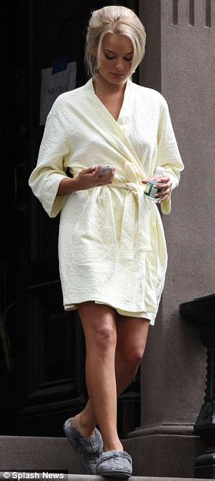 Margot Robbie Goes From Dressing Gown To Seductive Mini