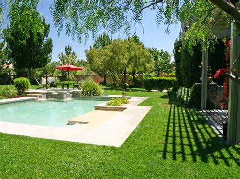 pool landscaping ideas hgtv lush garden pool with outdoor sitting area hgtv