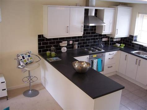 black and kitchen wall tiles throughout kitchen