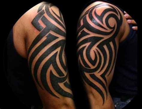 tribal tattoos are good choice of body art ohh my my