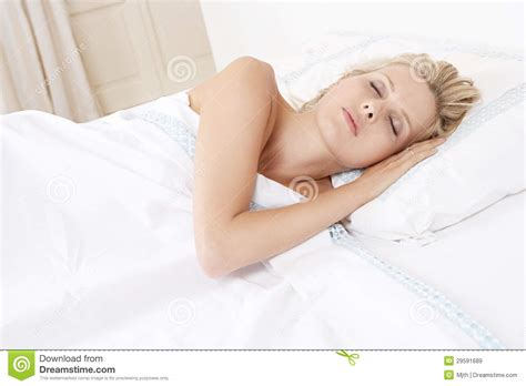 woman sleeping in bed young woman sleeping in bed royalty free stock images image 29591689