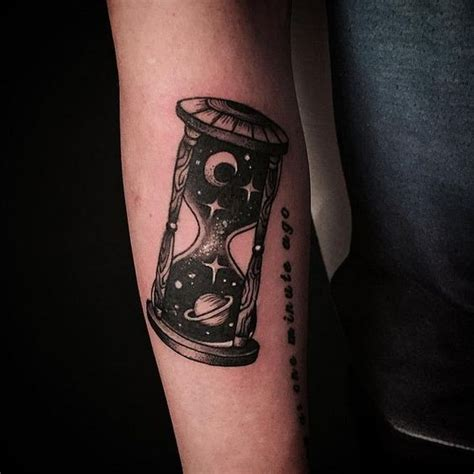 unusual black ink space hourglass tattoo on arm tattoos pm