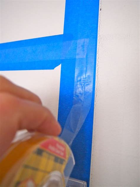 how to put photos on wall without tape painters tape trick double stick tape painters tape and
