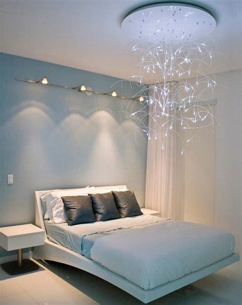 sleek modern bedroom design with lovely lighting and a