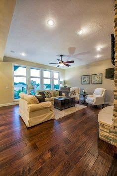 great room flooring 3 car garage family home plans and craftsman on