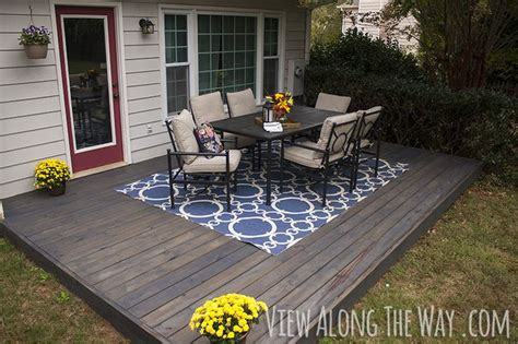 wood deck concrete patio diy deck a concrete patio and tips for staining your