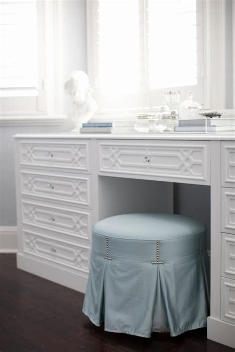 blue skirted vanity stool with make up table below