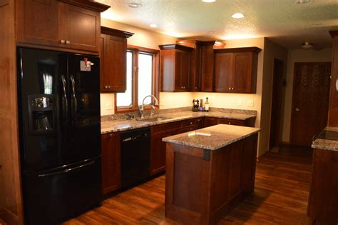 black stainless appliances with cherry cabinets glamorous vinyl plank flooring trend other metro