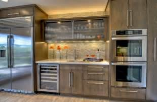 Glass Door Kitchen Cabinets Reeded Glass Cabinet In The Center Offers Textural Contrast In This Kitchen Space Decoist