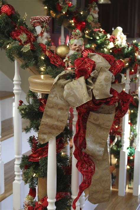 decorated christmas stairs  ribbon garland  mark roberts christmas elves christmas