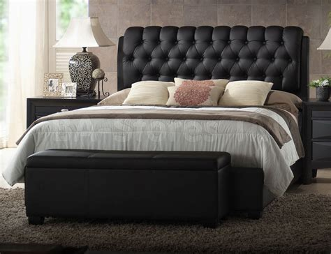 dark grey wooden bed with white leather headboard next to white leather tufted bed nauman tufted panel bed peyton