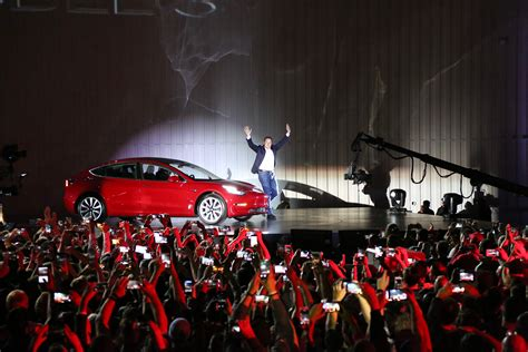 elon musk events tesla s model 3 and apple s iphone have a few things in