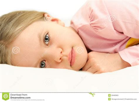 bed eyes a little girl lying in bed with open eyes stock photos image 29460903